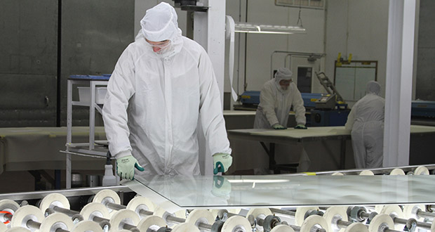 A Viracon employee works at the company's Owatonna plant. Minnesota's unemployment rate dipped to 3.3% in August, state Department of Employment and Economic Development said Thursday. (Submitted photo: Viracon)