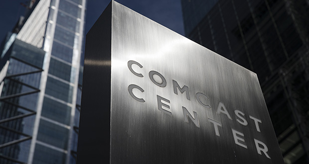 This May 21, 2018, file photo shows a sign outside the Comcast Center, which Liberty Property Trust built, in Philadelphia. (AP Photo/Matt Rourke, File)