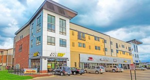 Six investors related to The Tailwind Group in Mankato have sold its Lofts 1633 project at 1633 Monks Ave. for $6.35 million. The 41,380-square-foot building includes commercial tenants on the first floor and apartments on the second floor. (Submitted photo: Tailwind Group)