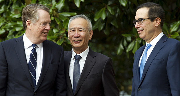 Chinese Vice Premier Liu He accompanied by U.S. Trade Representative Robert Lighthizer, left, and Treasury Secretary Steven Mnuchin, greets the media Oct. 10, 2019 before a minister-level trade meeting in Washington. (AP Photo: Jose Luis Magana)