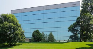 The Quadrant Office Building at 7100 Northland Circle N. in Brooklyn Park is now at full occupancy after improvements made by its former owner, Hempel Cos., drew new tenants. (Submitted photo: CoStar)