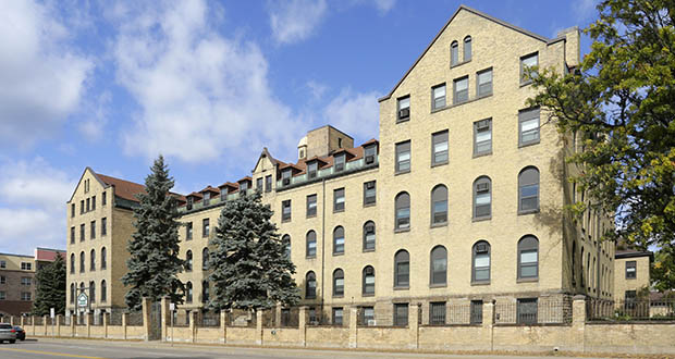 The Stonehouse Square apartments at 2015 Broadway St. NE in Minneapolis originally were built as a home for the aged by the Little Sisters of the Poor. The earliest parts of the building date to the 1890s. (Submitted photo: CoStar Group)
