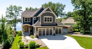 This nearly $1.5 million home at 14263 Shady Beach Trail NE packs 4,987 square feet of space, a three-car garage and two decks on a 0.31-acre lot that's just 50 feet wide at the shoreline. (Submitted photo: Chris Rooney)