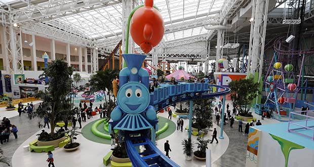 Visitors to the American Dream mega entertainment and shopping complex in East Rutherford, N.J., ride Dora's Sky Railway, Friday, Oct. 25, 2019. (AP Photo/Richard Drew)