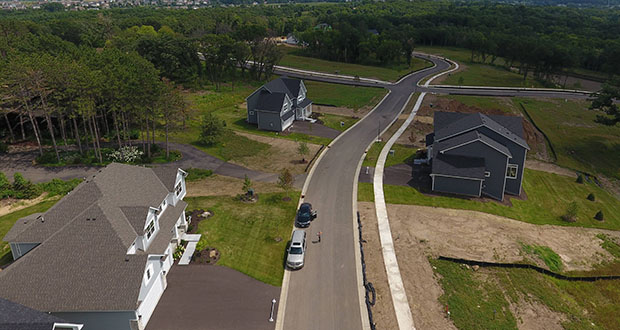 This aerial photo shows how Gonyea Custom Homes created the new award-winning Eastbrooke community in Cottage Grove using small lots, a variety of common areas and public trails to preserve the natural setting. Eastbrooke is near the crossroads of Interstates 94, 494 and 694. (Submitted photo: Gonyea Companies)