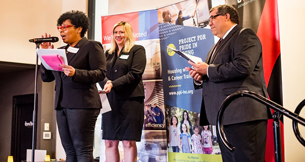 Juxtaposition Arts CEO DeAnna Cummings, from left, Bank of America Market President Katie Simpson and Project for Pride in Living CEO Paul Williams at an event Thursday. Bank of America awarded $200,000 Neighborhood Builders grants to both groups. (Submitted photo: Bank of America)