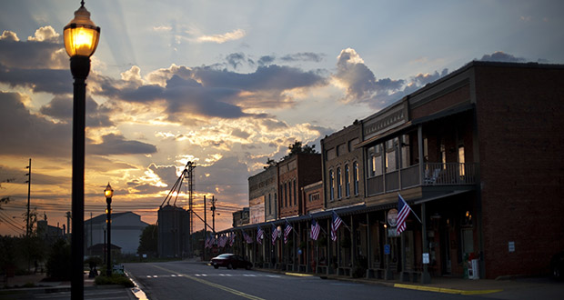 The median sales price for a business edged up just 0.1% during the third quarter from a year earlier, said BizBuySell.com, which based its findings on a survey of small business brokers across the country. In this Aug. 23, 2015, photo, the sun rises behind Main Street in Plains, Georgia. (AP file photo)