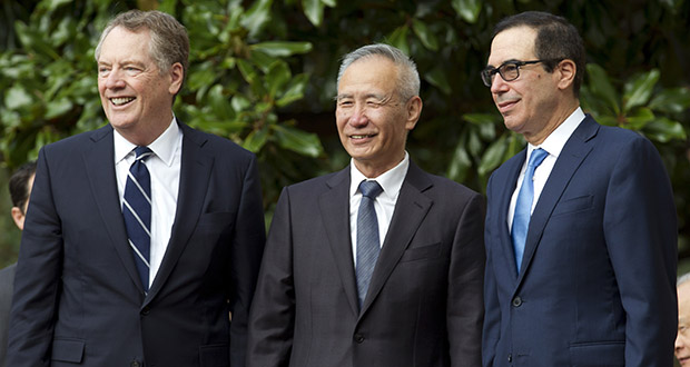 In this Oct. 10 photo, Chinese Vice Premier Liu He is accompanied by U.S. Trade Representative Robert Lighthizer, left, and Treasury Secretary Steven Mnuchin, during minister-level trade meetings at the Office of the United States Trade Representative in Washington. The U.S. and China are trying to finalize a modest trade agreement to de-escalate a trade war that has rattled financial markets and hobbled global economic growth. (AP file photo)