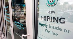 A job posting is displayed near the entrance of a restaurant Nov. 4 in Orlando, Florida. (AP file photo)