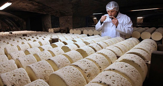 The Trump administration is proposing tariffs on up to $2.4 billion worth of French imports, from Roquefort cheese to handbags, retaliation for France's tax on American tech giants like Google, Amazon and Facebook. In this Jan. 21, 2009, photo, Bernard Roques, a refiner of Societe company, smells a Roquefort cheese as they mature in a cellar in Roquefort, southwestern France. (AP file photo)