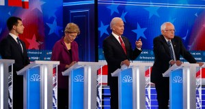 In this Nov. 20 file photo of an earlier Democratic presidential primary debate in Atlanta, former Vice President Joe Biden, second from right, speaks as candidates Sen. Bernie Sanders, I-Vt.,, right, and South Bend, Ind., Mayor Pete Buttigieg, left, and Sen. Elizabeth Warren, D-Mass., second from left, watch. (AP file photo)