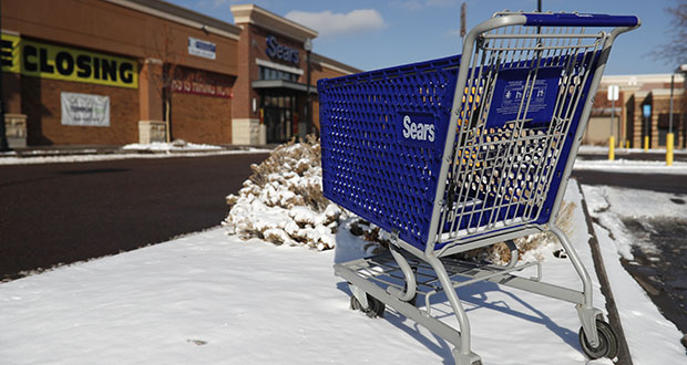 An empty shopping cart sits outside a Sears store Jan. 1 in the Streets of Southglenn Mall in Littleton, Colorado. Sears once towered over the retail landscape but has been on a slow decline for years. (AP file photo)