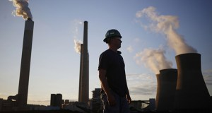 This July 18, 2018 photo shows a worker in the coal yard at the American Electric Power Co. Inc. coal-fired power plant in Winfield, West Virginia. (Bloomberg file photo)