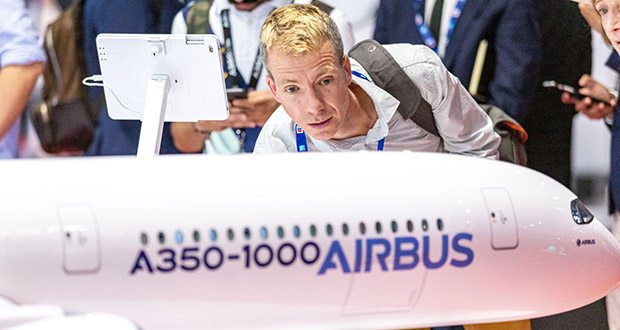 A World Trade Organization panel ruled Monday that the European Union has not complied with an order to end illegal subsidies for plane maker Airbus. In this Nov. 17 photo, an attendee inspects an Airbus SE A350-1000 scale model aircraft in the Airbus pavilion on the first day of the 16th Dubai Air Show in Dubai, United Arab Emirates. (Bloomberg file photo)