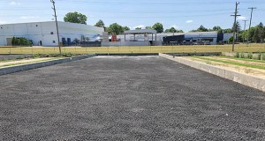 This July 31, 2019 photo shows sewage sludge from the Lapeer Wastewater Treatment Plant in drying beds, where it is being stored until an arrangement is made for permanent disposal, in Lapeer, Mich. (AP Photo/John Flesher)