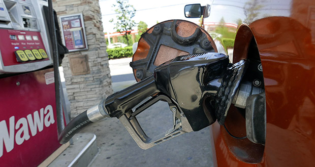 In this Sept. 17, 2019 file photo, a car fills up at a gas pump in Orlando, Fla. (AP Photo/John Raoux, File)