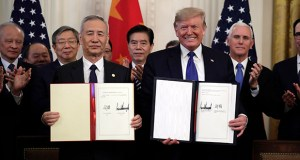 """In this Wednesday, Jan. 15, 2020, file photo, U.S. President Donald Trump, right, holds the signed trade agreement with Chinese Vice Premier Liu He Wednesday in the East Room of the White House, in Washington. China's government welcomed an interim trade deal with Washington and said Thursday the two sides need to address each other's """"core concerns."""" (AP file photo)"""