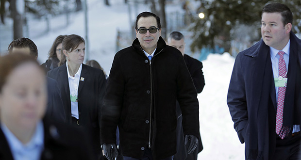 Steven Mnuchin, United States Secretary of the Treasury, walks through the snow Wednesday during the annual meeting of the World Economic Forum in Davos, Switzerland. Members of Trump's Cabinet have talked up the prospects of a swift trade deal with Britain once it leaves the European Union and argued that it should be relatively straightforward given how similar the two economies are. (AP Photo: Markus Schreiber)