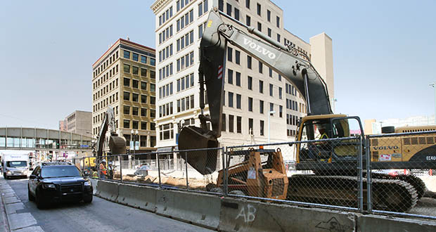 The past three months have seen construction employment waver after many months of growth, according to figures from the Department of Employment and Economic Development. In this photo, a construction crew works on Hennepin Avenue in Minneapolis in July. (File photo: Bill Klotz)