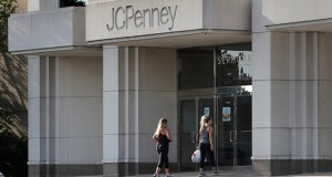 In this Aug. 14, 2019, file photo two women walk into the JCPenney store in Peabody, Mass. J.C. Penney Co. reports earnings Thursday, Feb. 27. (AP Photo/Charles Krupa, File)