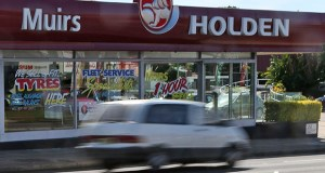 In this 2013 photo, a car drives past a car dealership of Holden, General Motors Co.'s Australian subsidiary, in Sydney, Australia. (AP file photo)