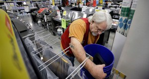 Lowe's reported fiscal fourth-quarter net income of $509 million Wednesday, after reporting a loss in the same period a year earlier. In this Feb. 23, 2018, photo sales associate Bob Henriques moves items at a Lowe's retail home improvement and appliance store in Framingham, Massachusetts. (AP file photo)