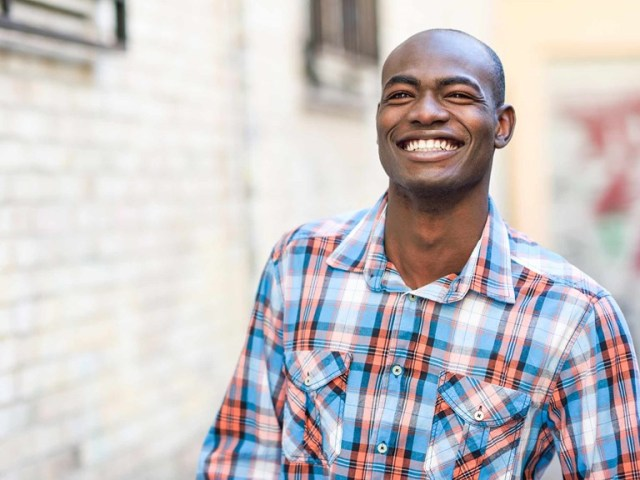 PICTURE OF A MAN HAPPY TO HAVE OPEN ZENITH BANK ACCOUNT