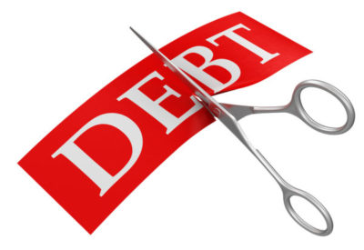 Scissors and debt. Image with clipping path