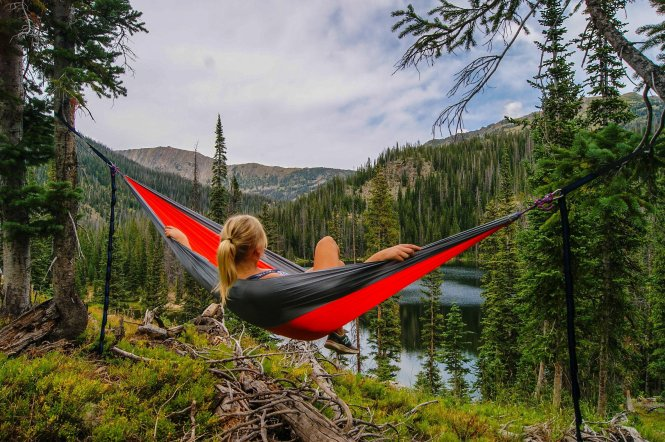 Hiker relaxing in hammock
