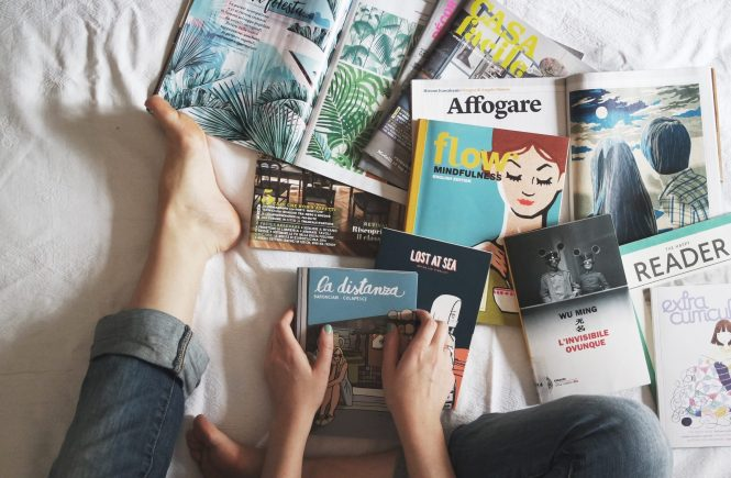 woman one bed surrounded by books