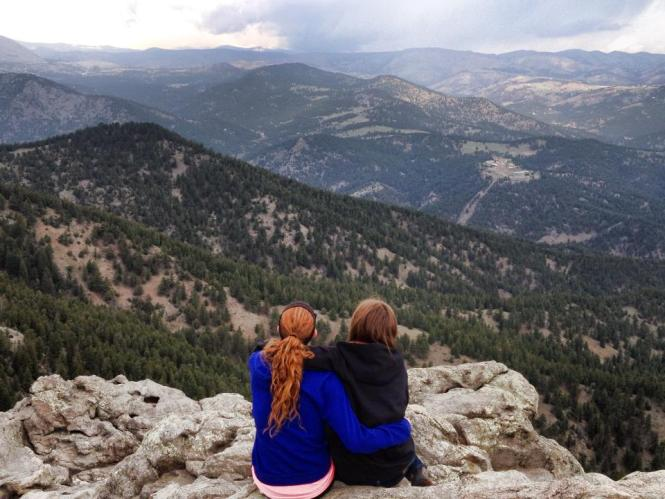 two women looking out over the mountains