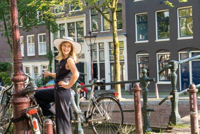 woman posed on dutch bike in amsterdam