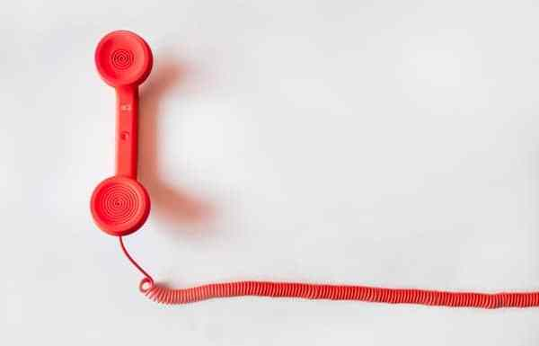 Photo of a red phone receiver signaling changing my voicemail