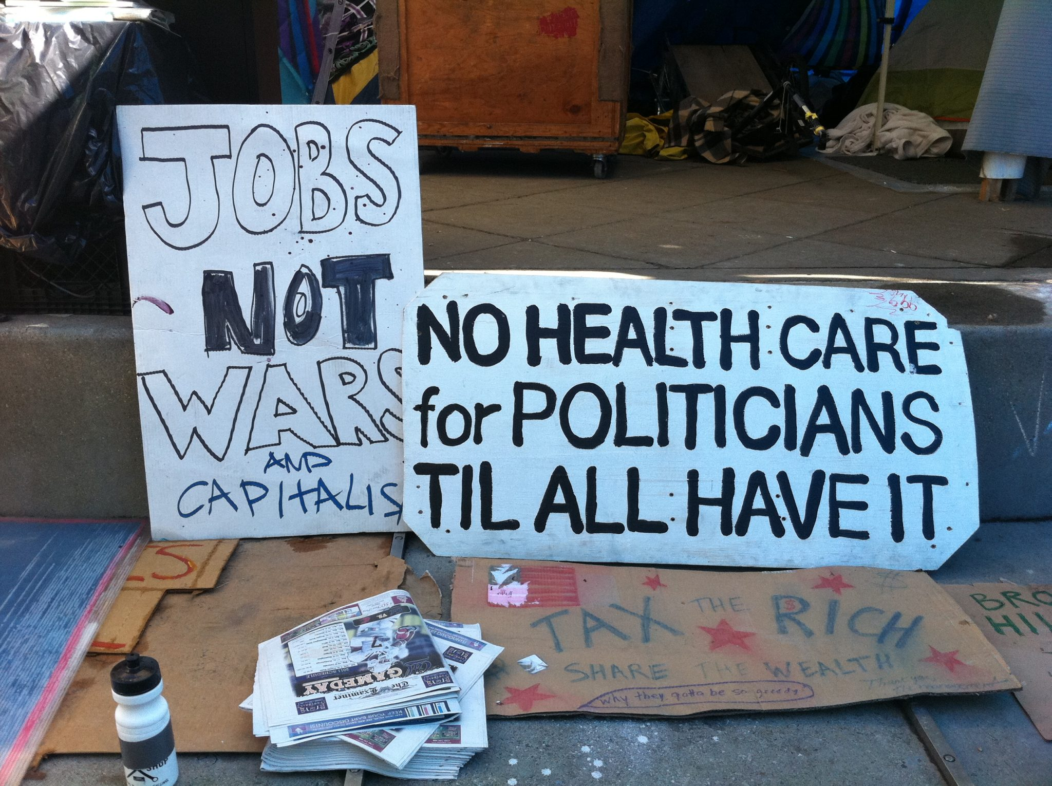 Occupy Protesters - Working Is To Capitalism As Retirement Is To Socialism