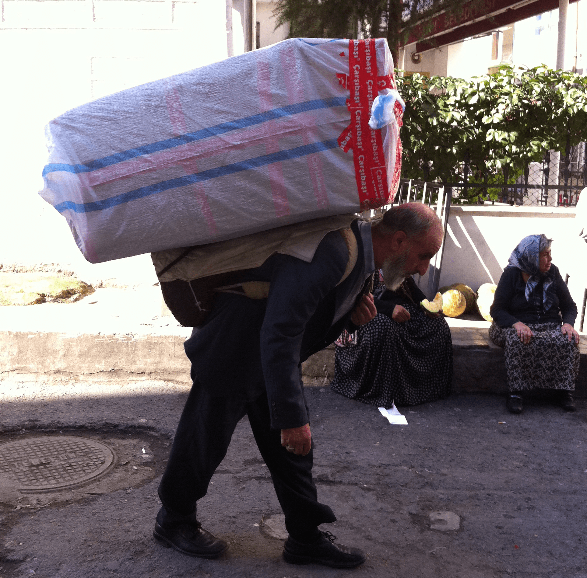 Old Man Carrying A Heavy Load - A Day Job Is So Much Easier Than Entrepreneurship