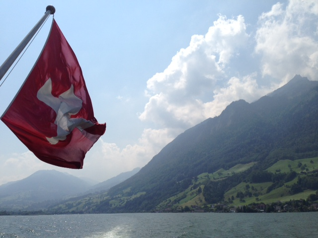 Swiss Flag Waving In Mountain Range - Do You Suffer From Apathy? Here's How To Care Again