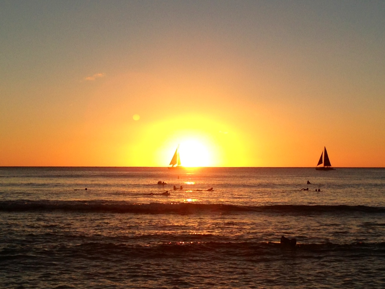 Hawaiian Sunset With Sailboat In Retirement