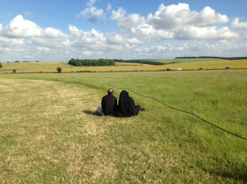 Couple Gazing In The Fields At Stone Henge