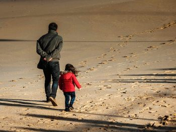 Father and daughter walking on the beach - Things I'll Teach My Daughter
