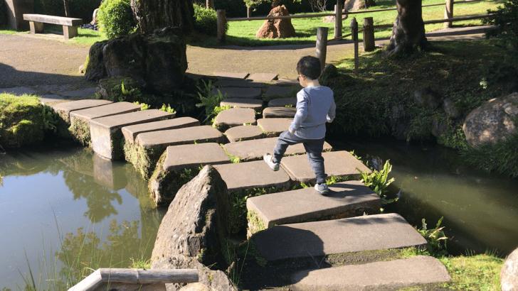 October 2020 recap - son walking over rock bridg