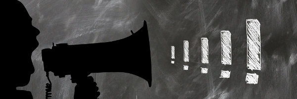 Rysnek przedstawiający osobę krzyczącą przez megafon