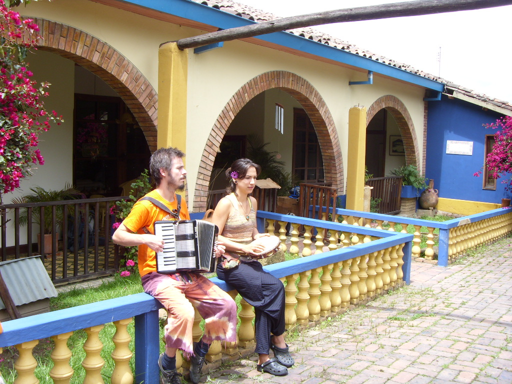 Travelers playing music outside in the garden