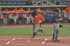 Owen Prince of LB scores a run for the West team at Liberty University.