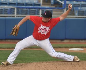 Hunter Wilson of the Knights pitches for the Red team.