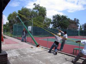 Installing lights on tennis courts, Mexico