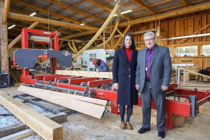 Finderne Development Trust Development Manager, Pery Zakeri, and Roddy Innes, Employment Engagement Advisor at Skills Development Scotland at Finderne business Logie Timber