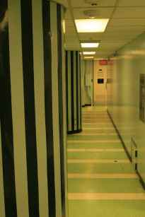 Inside the Diefenbunker - on Level 1 was located the infirmary and several other offices that have been re-purposed as museum exhibit spaces. The stripes painted on the columns are meant to give the illusion of more space in the constricted hallway areas.