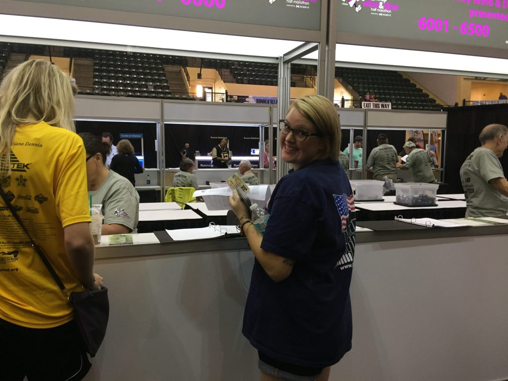 Hayley signing to pick up her race bib at a rundisney expo
