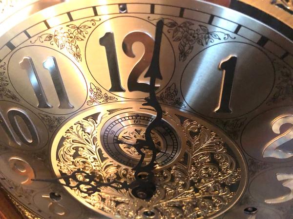 Fancy brass grandfather clock face