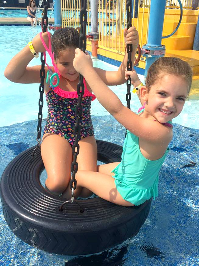 children on tire swing in Chalmer's Pool